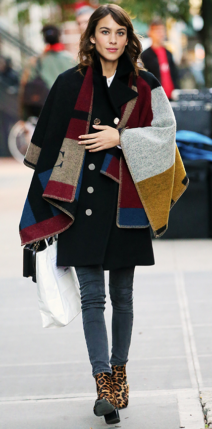 British fashionista and author Alexa Chung, wearing a Burberry monogrammed cape, jeans, and leopard print ankle boots, leaves a Glamour Magazine photoshoot in East Village on November 3, 2014 in New York City Pictured: Alexa Chung Ref: SPL881391  031114   Picture by: Christopher Peterson/Splash News Splash News and Pictures Los Angeles:310-821-2666 New York:	212-619-2666 London:	870-934-2666 photodesk@splashnews.com